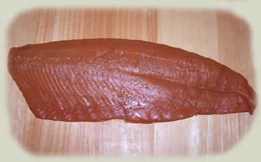 Cold smoked salmon commonly called Lox or Nova is cold smoking at its best.
